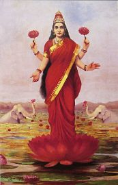 Hindu goddess Lakshmi standing on a lotus
